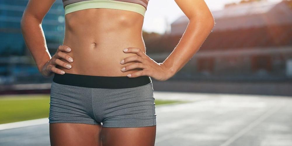 Female athlete wearing compression shorts.