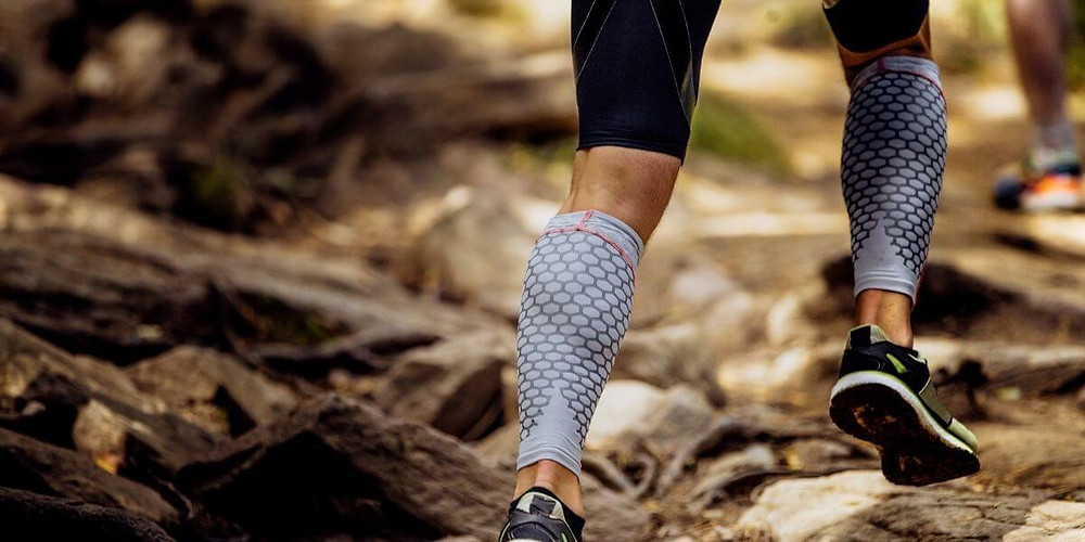 Runner wearing compression sleeves.