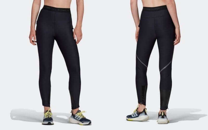 Athlete wearing Adidas Own the Run COLD.RDY Running Leggings.