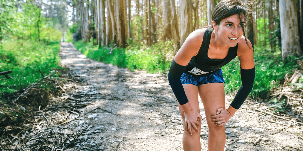 Runner wearing compression arm sleeves.