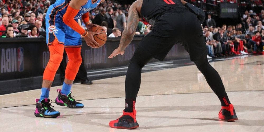Two NBA players wearing compression tights: 3/4 length vs. full-length tights.