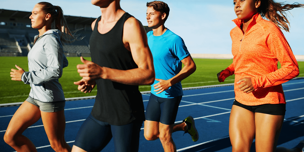 Male and female runners wearing compression shorts.