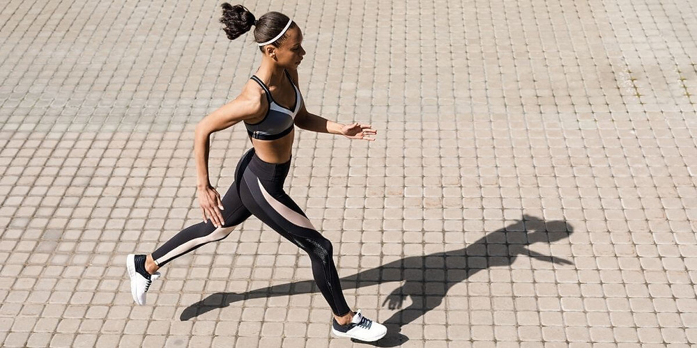 Female athlete running in compression wear.