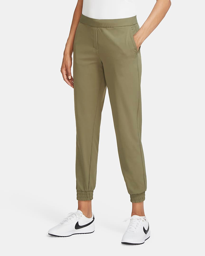 Woman in olive Nike Golf Joggers.