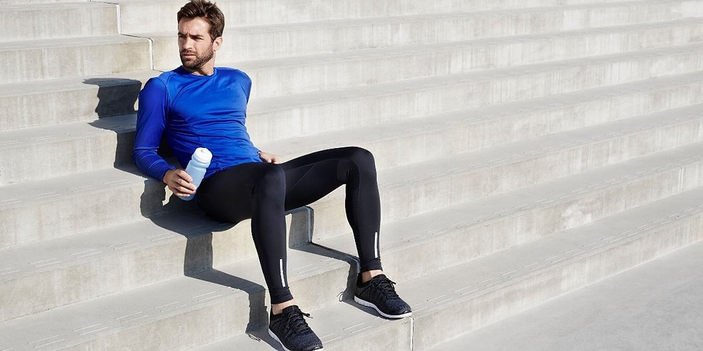 Male athlete wearing compression tights.