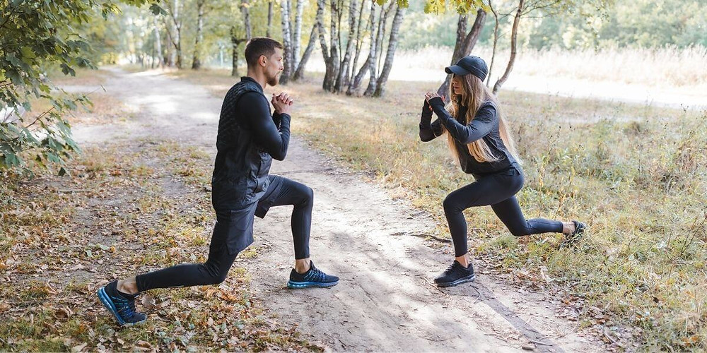 Woman wearing compression tights and man wearing compression tights with shorts.