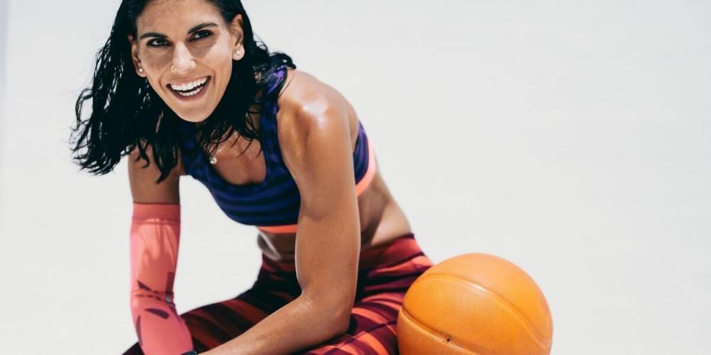 Female athlete wearing compression wear.