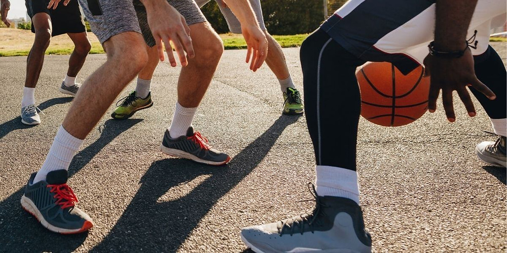 Basketball player wearing compression tights under his shorts.