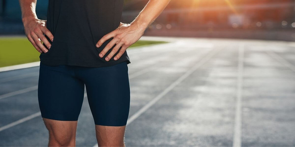 Male track and field athlete wearing compression shorts.