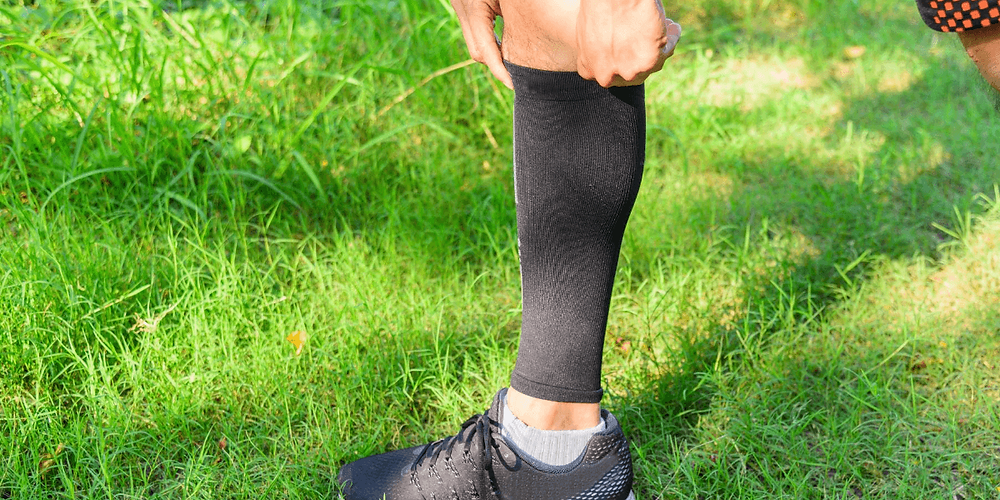 Athlete wearing compression calf sleeve.