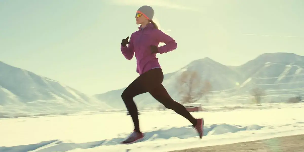 Female runner wearing cold weather running tights.