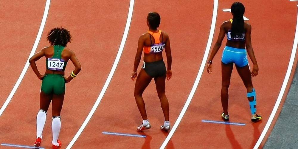 Track athletes competing in compression running shorts.