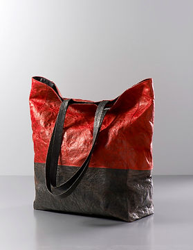 Parchment and leather handbags and wallets.