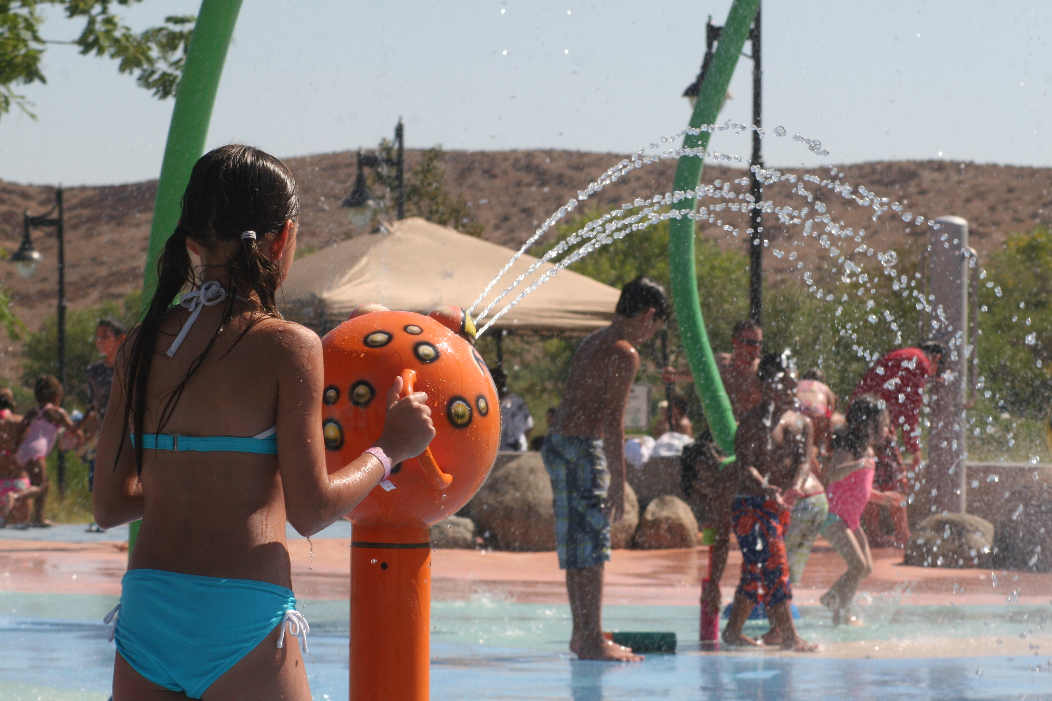 Kids enjoying splash pad at Skinner