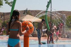 Kids enjoying splash pad at Skinner