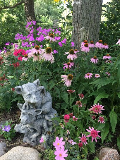 Stone statue paired with flowers
