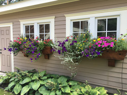 Brighten a garage with window boxes