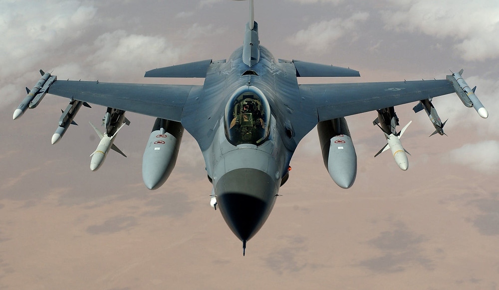 A fighter jet loaded with missiles