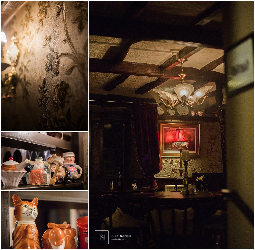 dark pub with gold brocade wallpaper