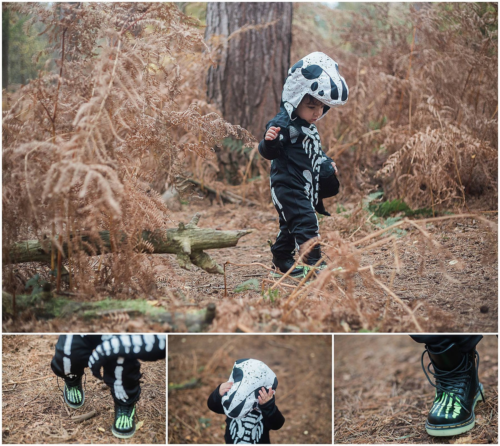 child in skeleton Doc Martins and a T-Rex suit