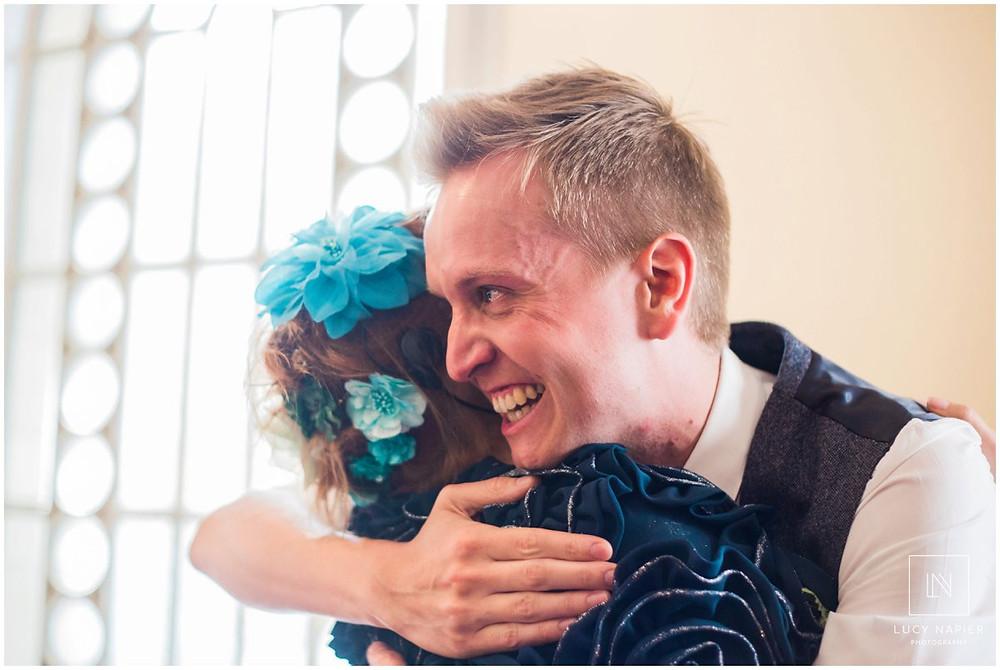 emotional groom hugs a guest