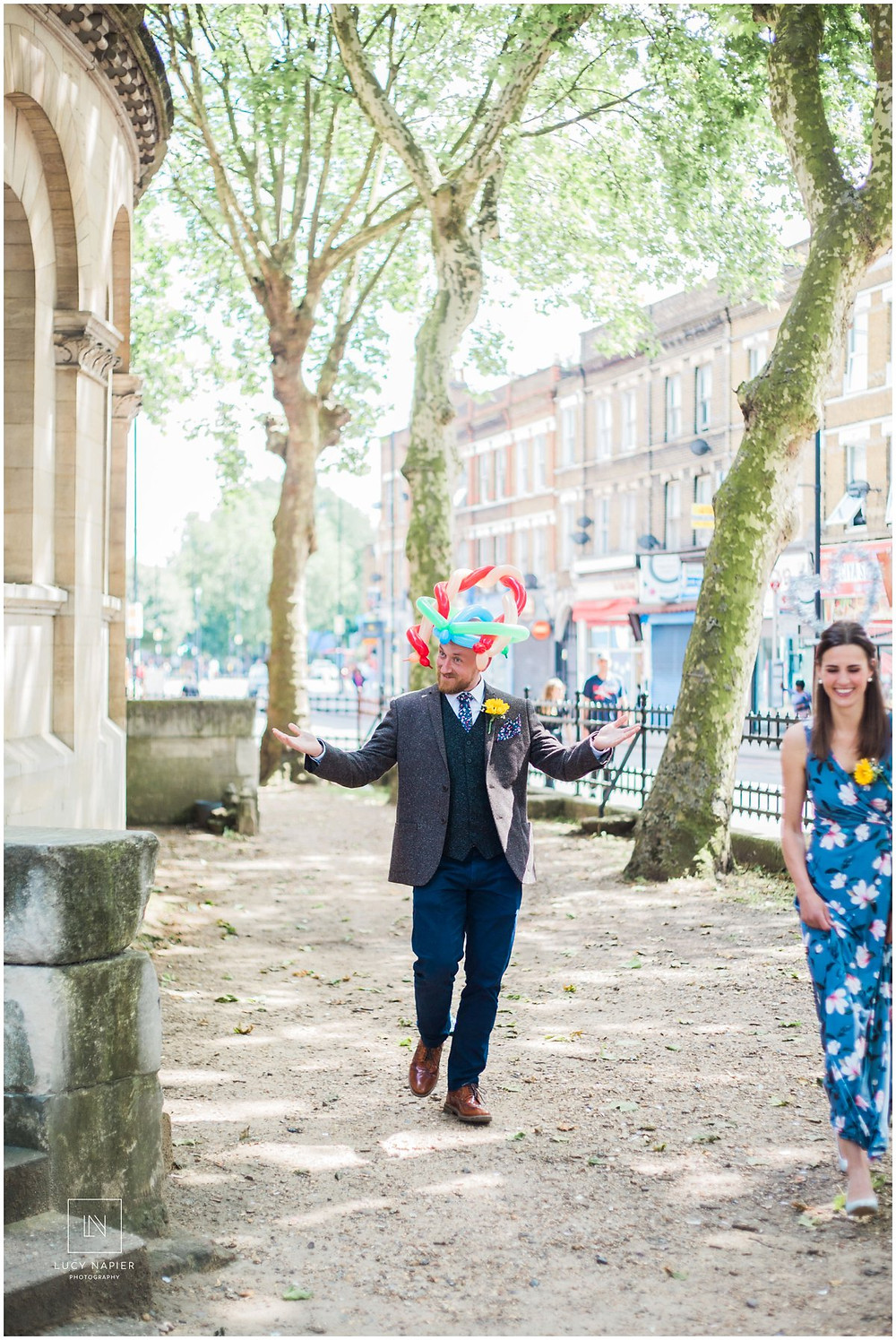man turns up to a wedding in a balloon hat