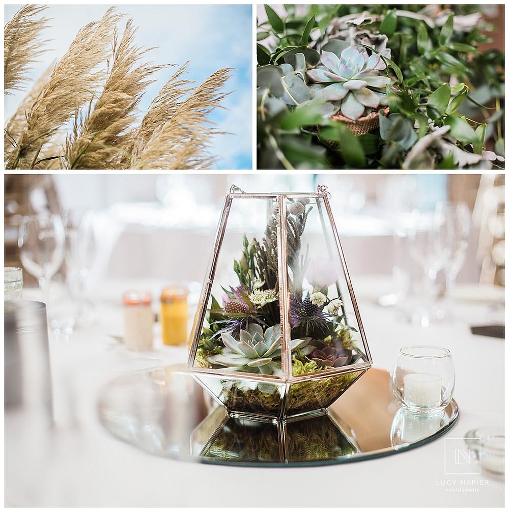 succulent centre pieces at a wedding in Owen House wedding barn