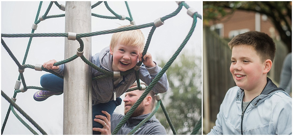brothers play on a climbing frame