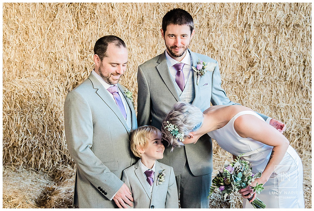 Family portraits in front of the hay bales Owen House Wedding Barn