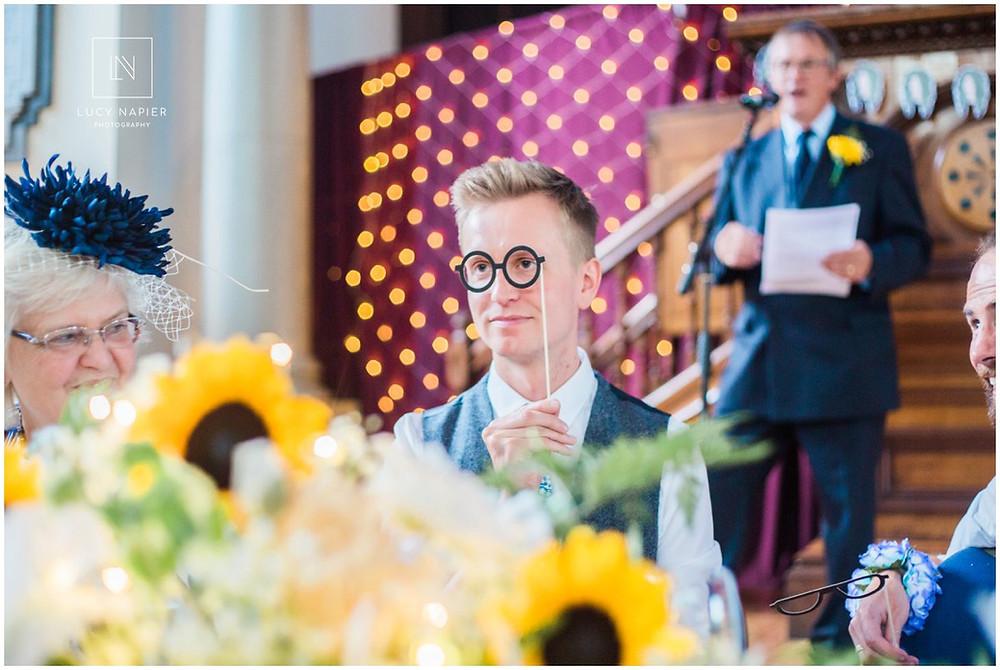 groom wears costume glasses