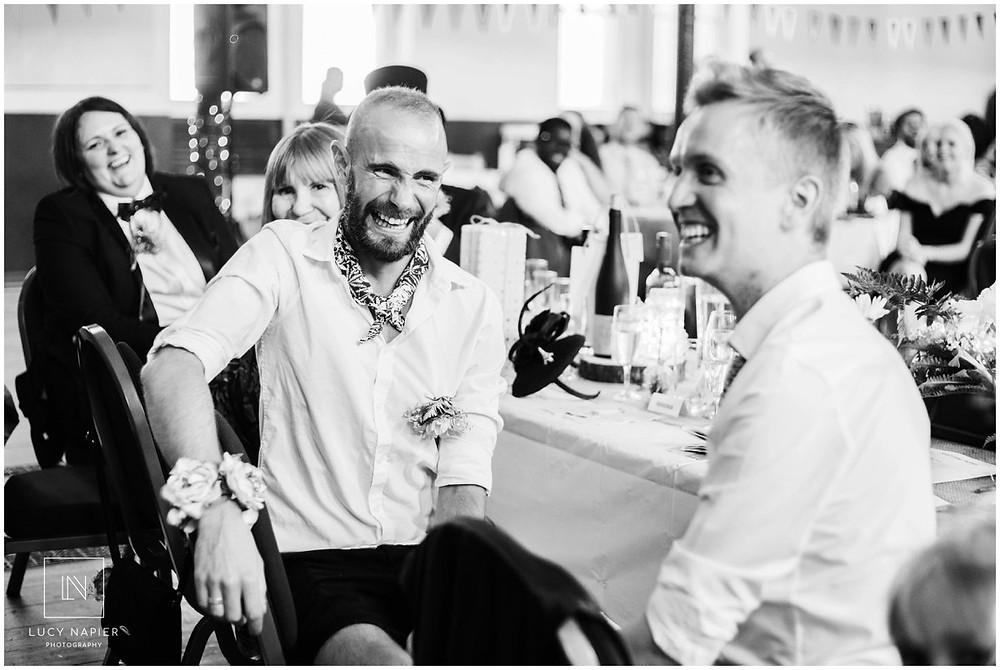 grooms laugh at speeches