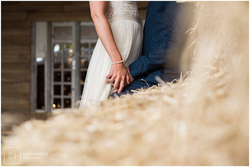 Holding hands in the hay bales