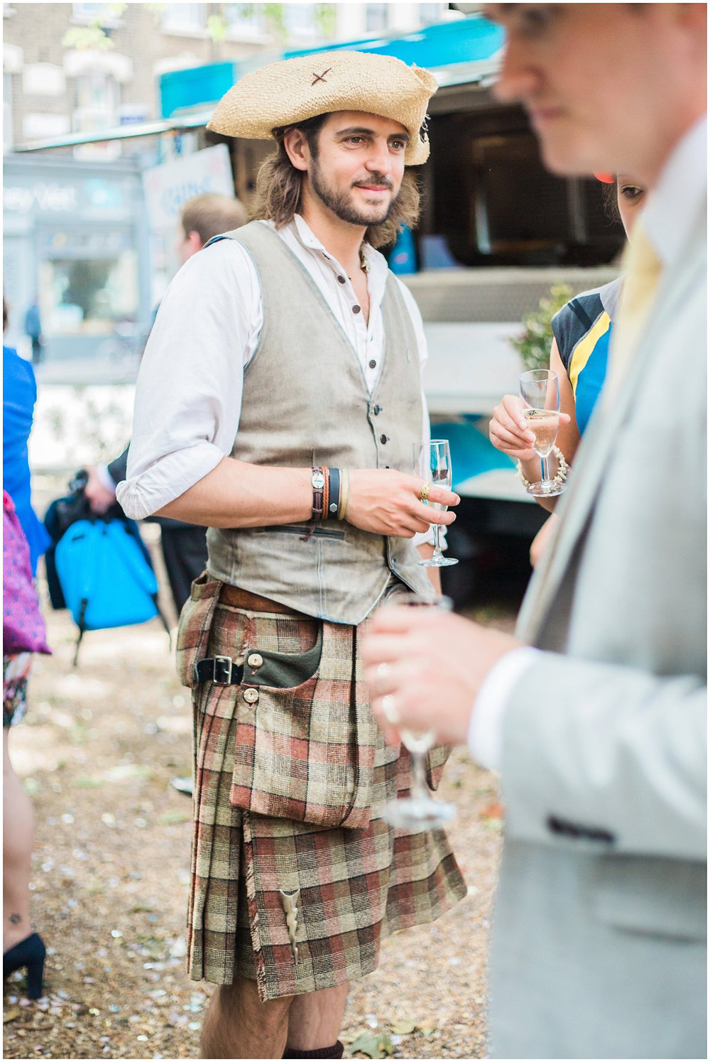 guest dressed in a kilt at a wedding
