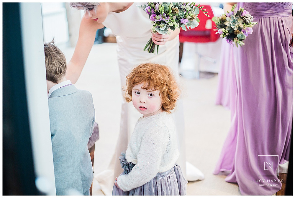 little flower girl waits for the bride to get ready.