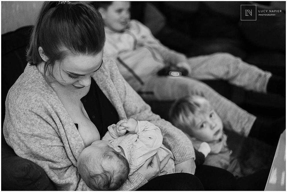 mother breastfeeds her child