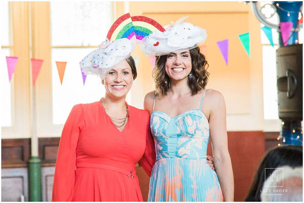 the winners of the home made hat competition with a rainbow hat