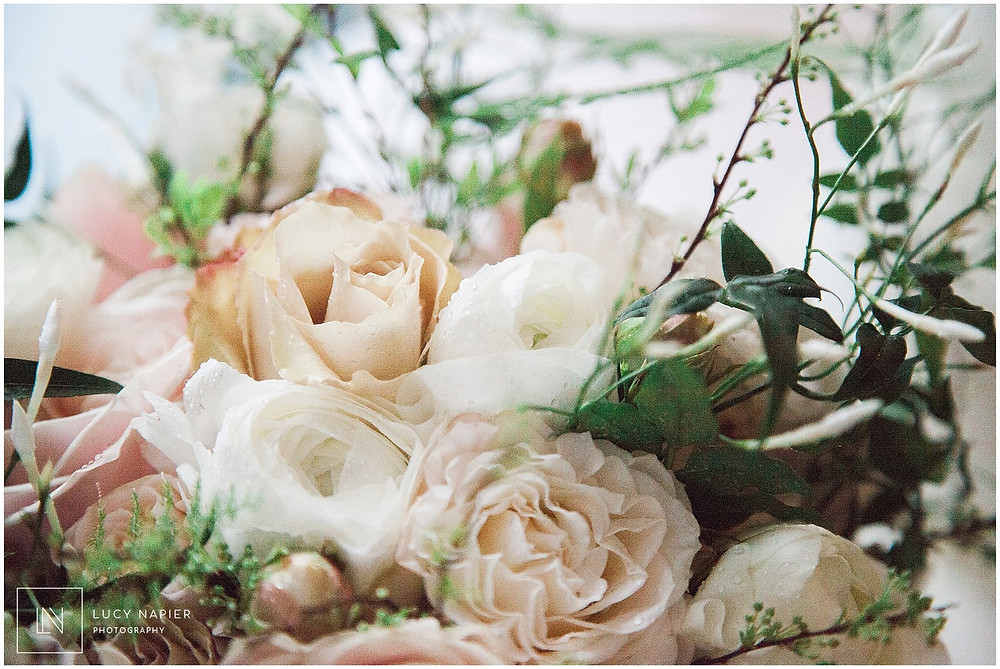 bridal bouquet of roses and ferns