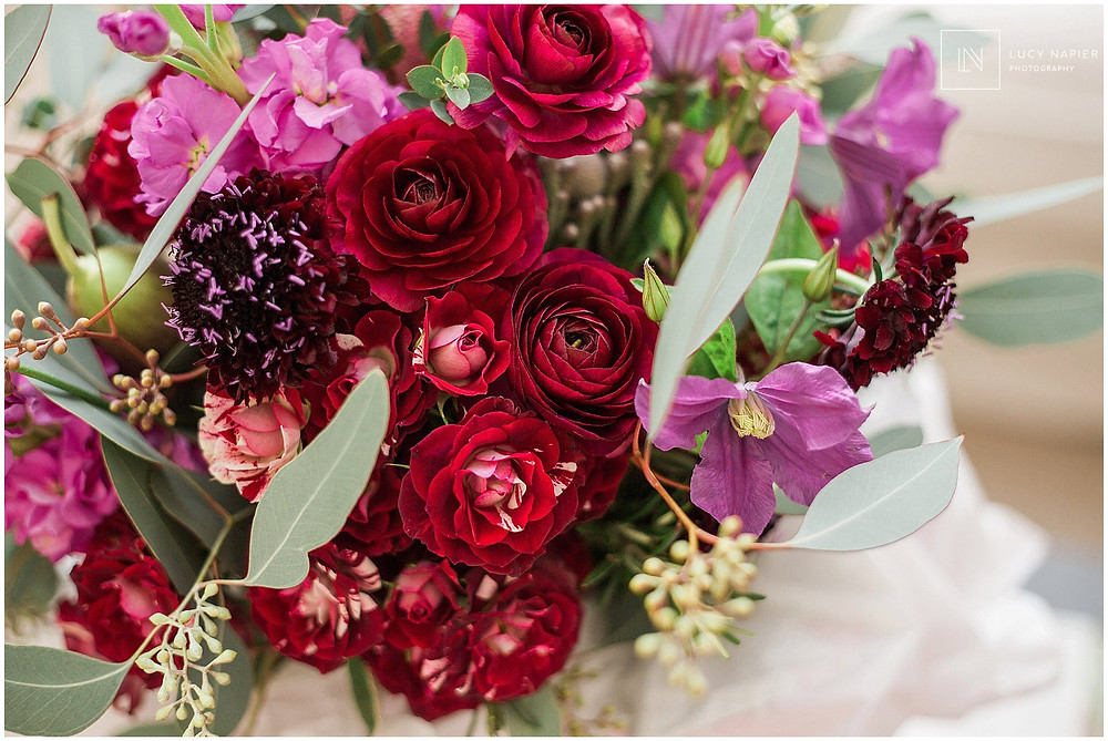 beautiful purple and red wedding bouquet