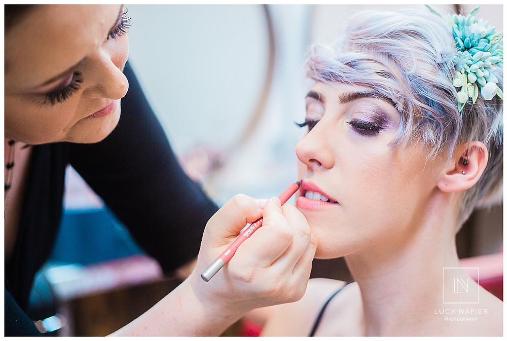 the bride getting her make up done