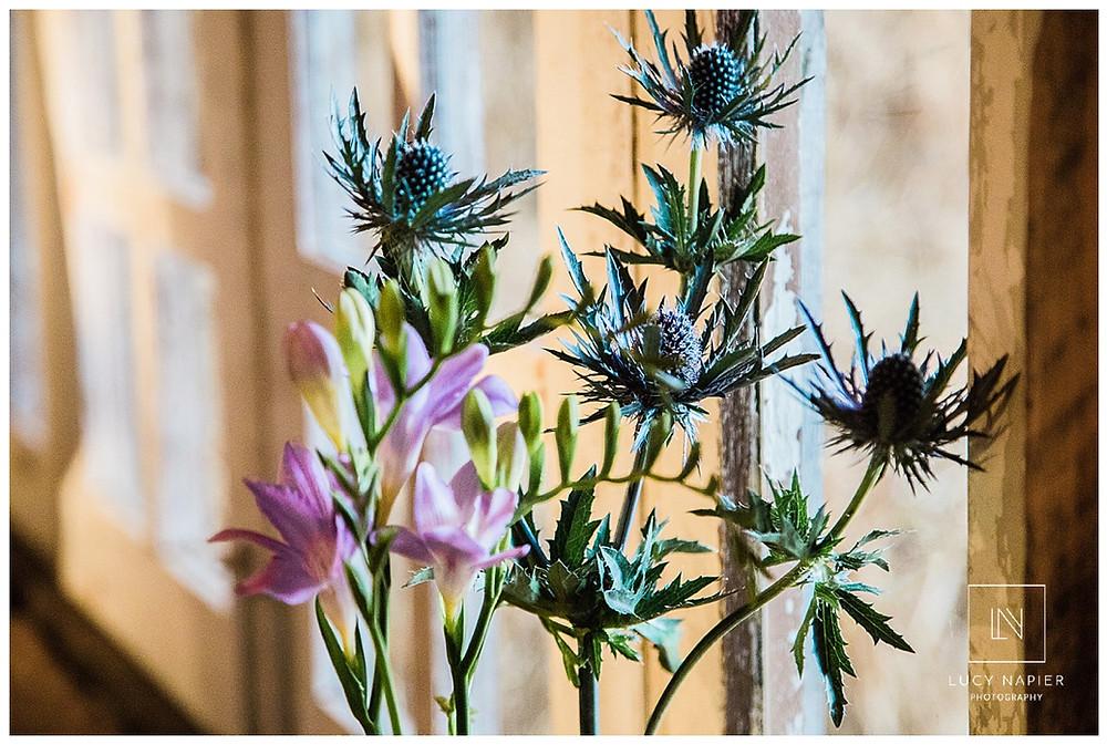 purple flowers in the ceremony room of Owen House Wedding venue