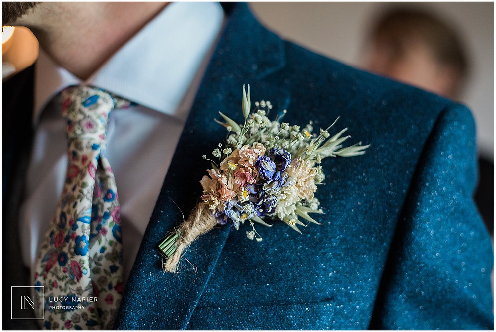 Dried flower button hole and floral wedding tie