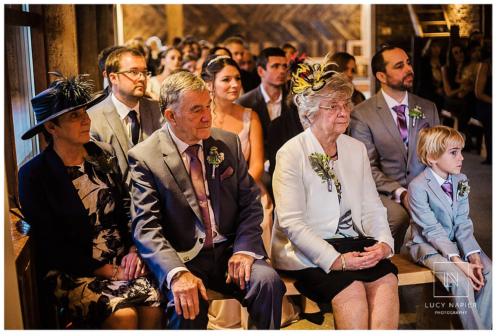 the grooms family watch the wedding ceremony from the front row