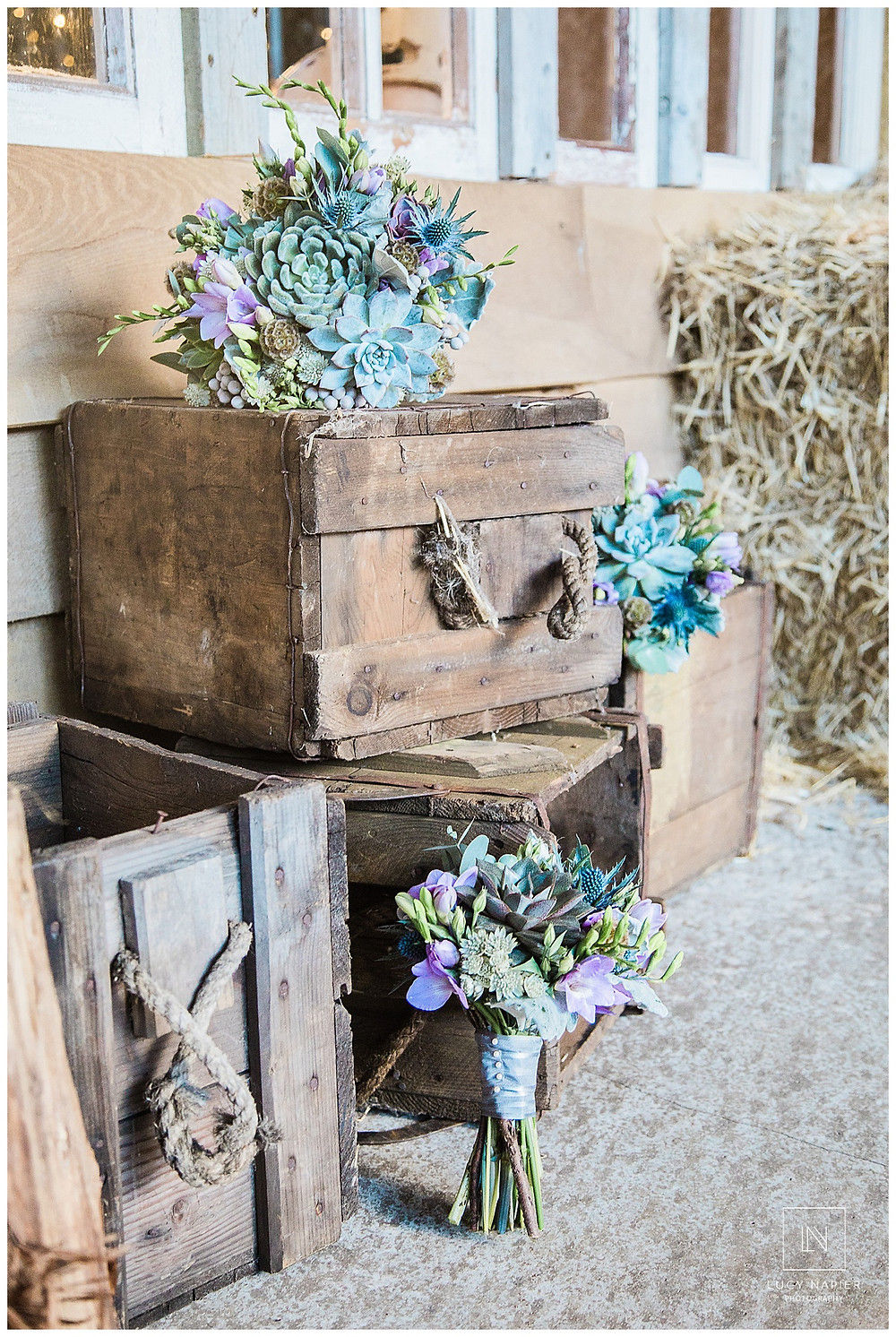 The wedding bouquets arranged on old crates