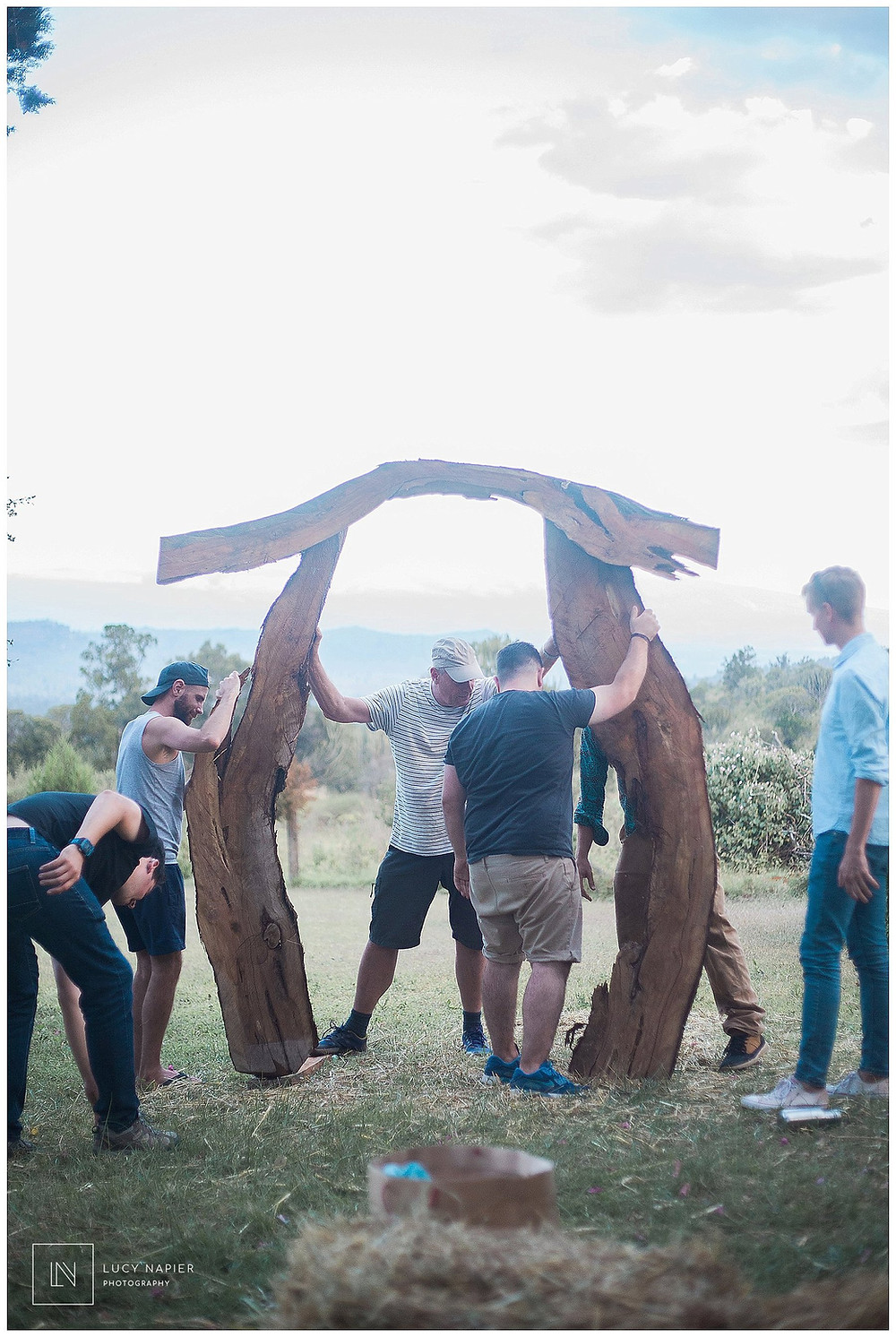 The wedding arch is put up by guests