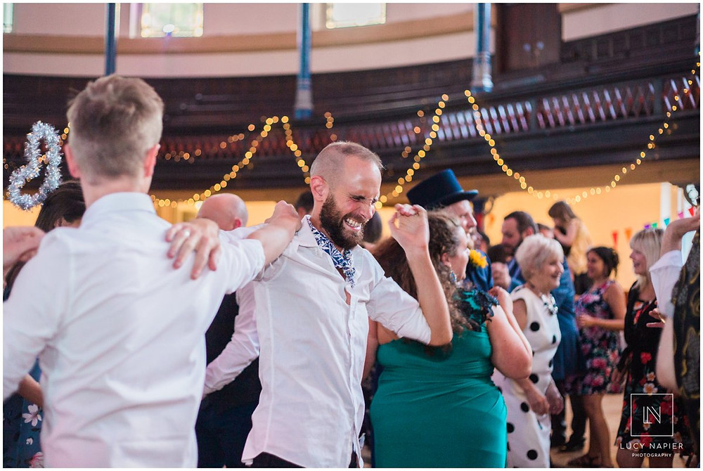 grooms dance at their wedding