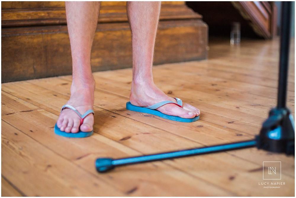 flip flops worn by the groom