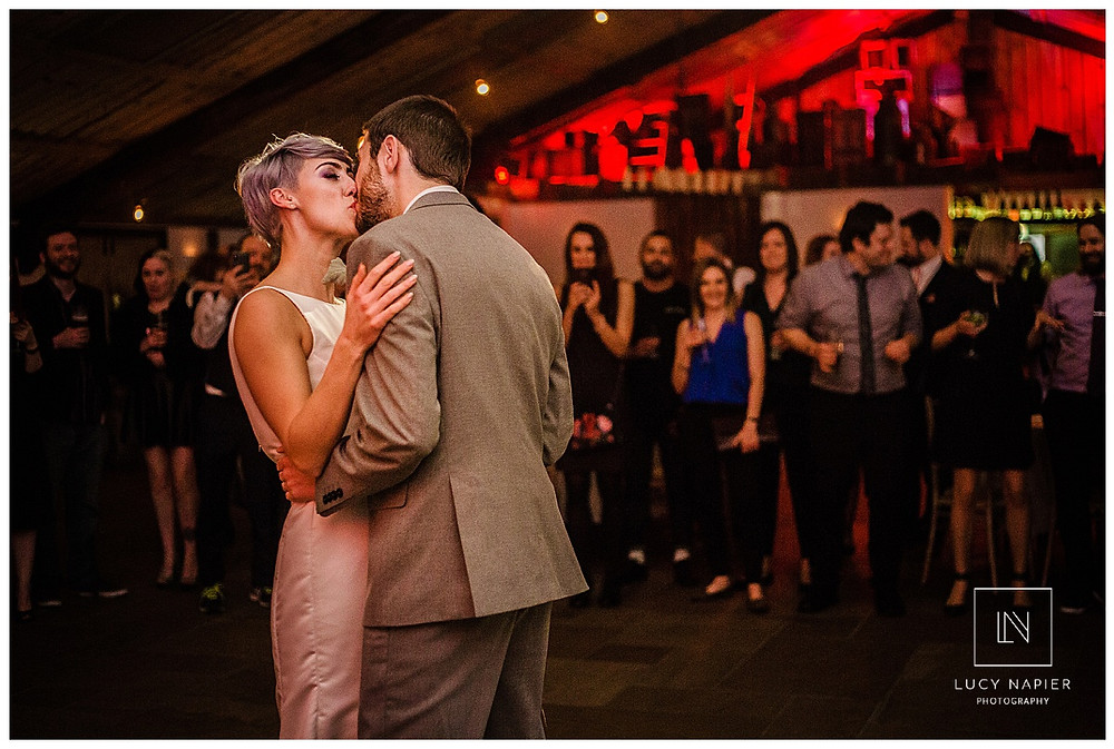 A kiss on the dance floor. The bride and groom kiss during the first dance