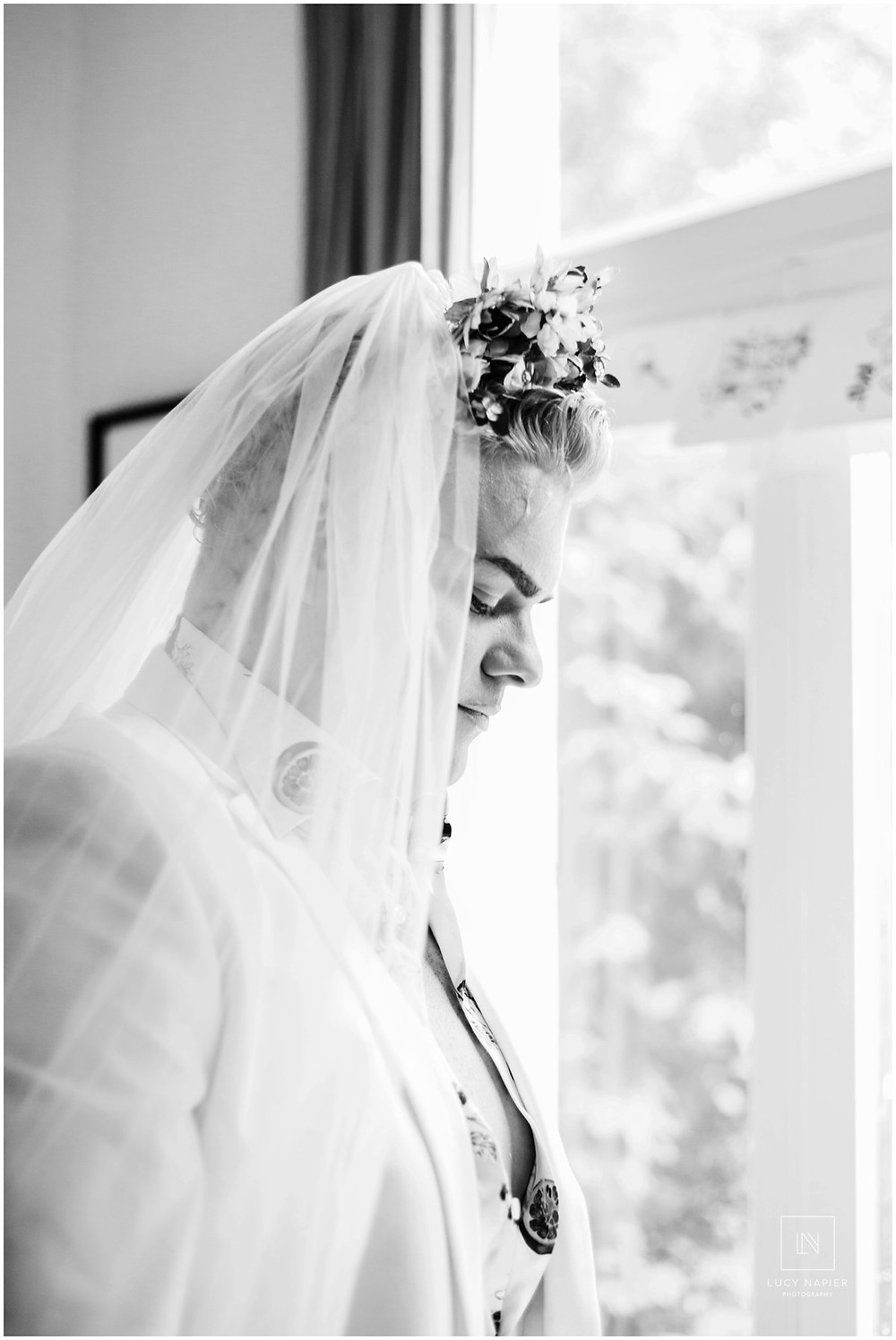 black and white image of a man dressed as a bride
