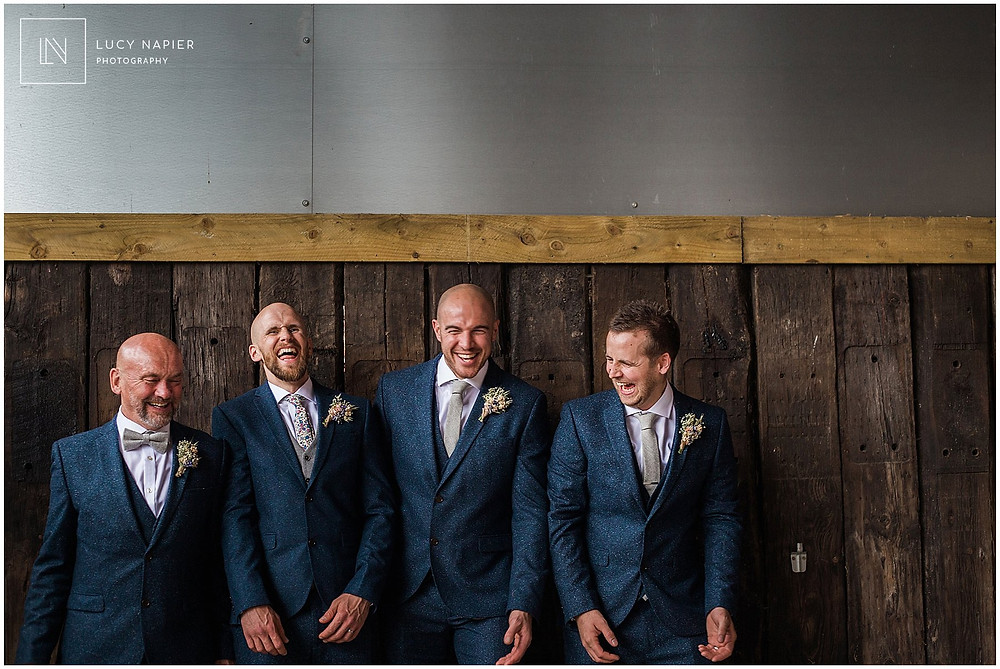 Groomsmen have a laugh at a Mobberley wedding
