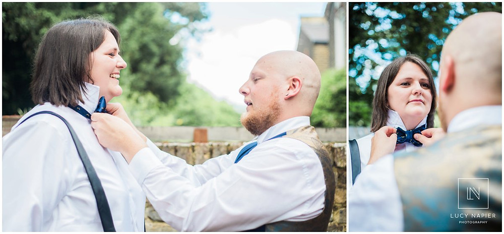 the best man and best woman adjust their bowties